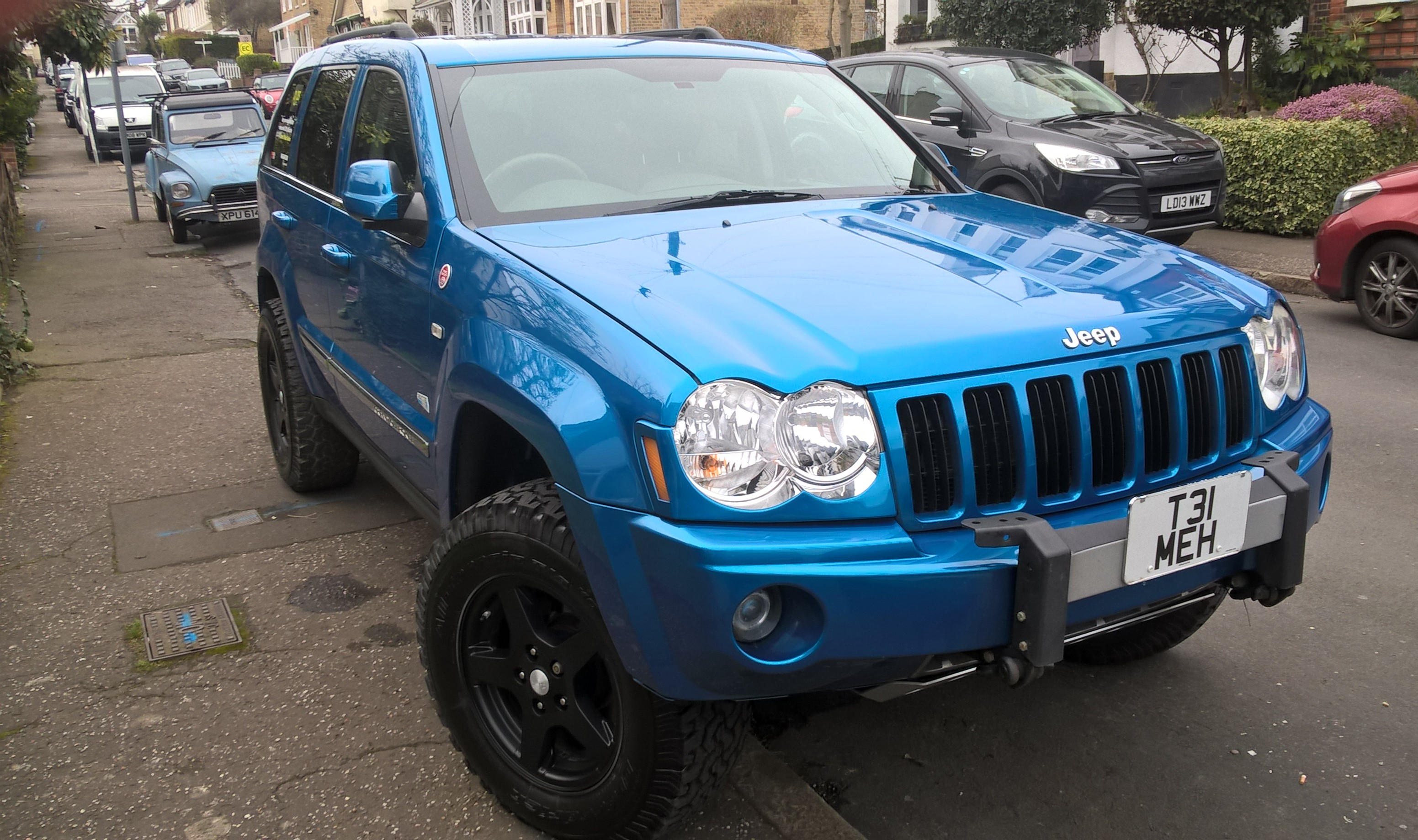 Jeep WK with BF Goodrich 265 70 R17 Load C KO tires